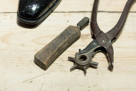 making hole: Shoemakers tools on Wooden Worktop Bench