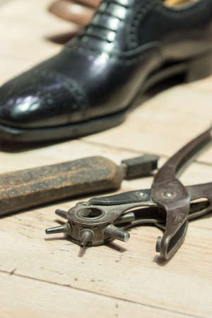 hole punch: Shoemakers tools on Wooden Worktop Bench
