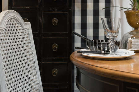 vintage furniture: Classic Vintage Table Setting with Antique Wooden Furniture Stock Photo