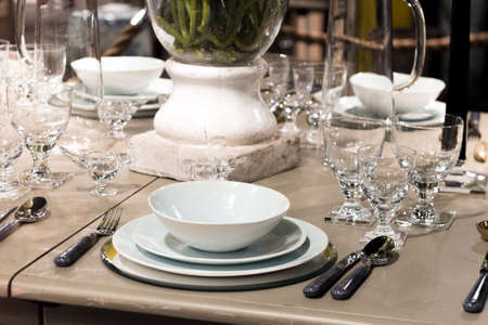 crockery: High-End Table Setting with Fine Cutlery, Glassware and Crockery Stock Photo