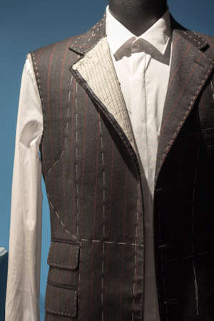 Work in Progress Suit on Mannequin with Exposed Stitching Stock Photo