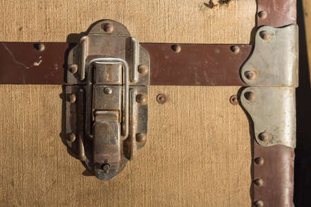 to clasp: Traditional Clasp and Latch Luggage Lock on Worn and Used Travel Trunk Chest Stock Photo