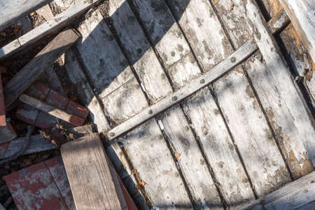 Close up of Interior of Wooden Row Boat with knotted wood and rusty rivets