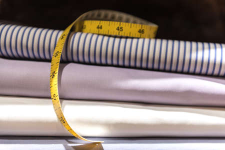 Tailor's Tape Measure and Fabric Swatches. Folded Mens Shirt Cloth