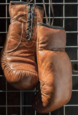 Boxing Gloves Hanging Up with Wire Grid Background 版權商用圖片