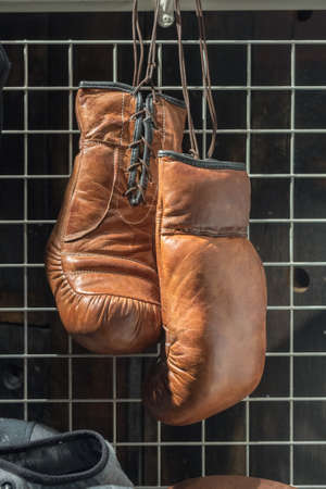 Boxing Gloves Hanging Up with Wire Grid Background 版權商用圖片 - 143076690