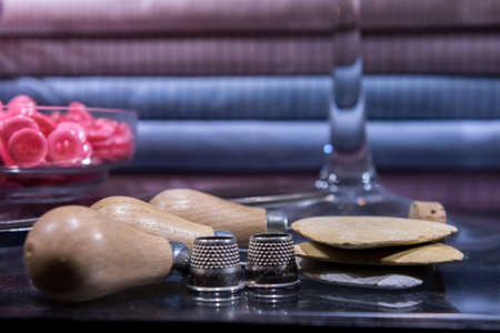Tailor's Table with Assorted Implements including awl, thimbles, buttons and chalk
