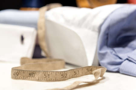 Tailor's Old Tape Measure with Shirt Cuffs and Cufflinks 版權商用圖片 - 143076729