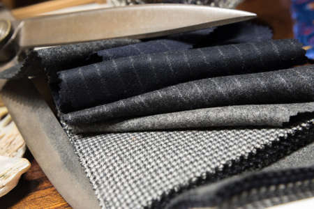 Assorted Suit Fabric Folded Between Large Scissors 版權商用圖片 - 142047968