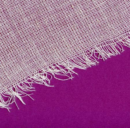 Canvas texture with fringe and violet background photo