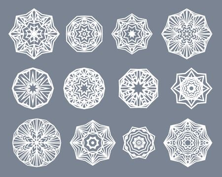decorative patterns: Mandalas set. White snowflakes isolated on gray background. Round decorative ornament patterns
