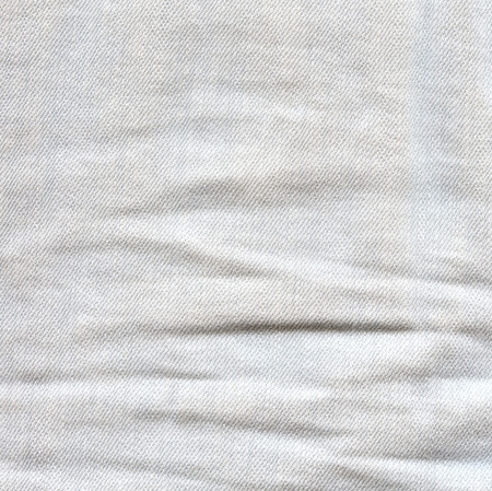 mezclilla: Light crumpled jeans background. Creased denim surface. White gray color canvas texture Foto de archivo