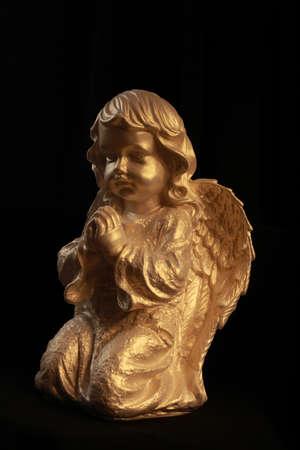 statuette in a prayer