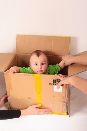 kid climbs out of the box