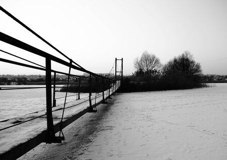 hanging bridge across the frozen river