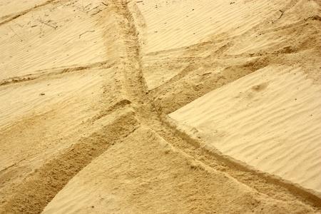wheel tracks in the sand Фото со стока