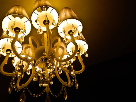 mystical interior with chandelier lights and reflections Stock Photo