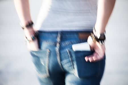 silhouette of a girl in stylish jeans with pockets Stock Photo