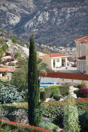 Mediterranean landscape in the mountains with the house and cypress