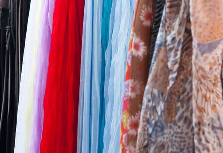 background of colorful fabrics and scarves