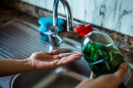 Woman washing her hands with soap in a hygienic way in her home sink. Kitchen Stok Fotoğraf