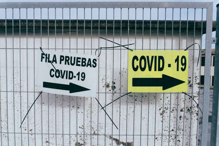 Informative signs on the street to perform the Covid-19 test in times of pandemic in Spain.