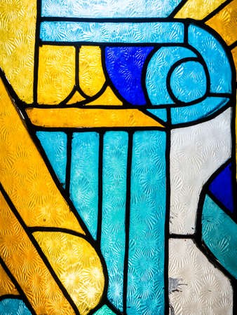 Pattern of colourful glowing Stained glass in interior Stock Photo