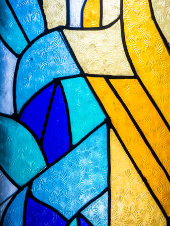 Pattern of colourful glowing Stained glass in interior