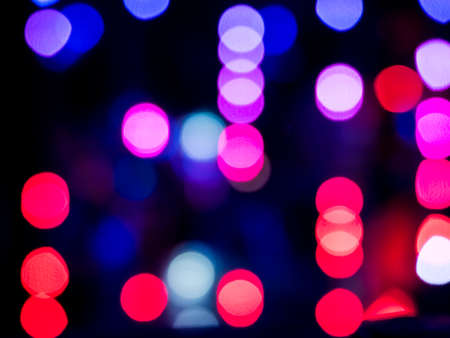 Abstract pattern of colour blurred bokeh neon lights at night club