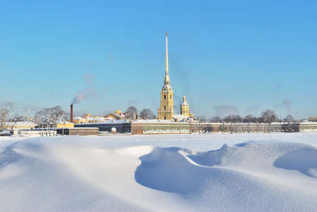 neva: St. Petersburg in winter. Peter and Paul Fortress and  frozen  snowy  Neva Stock Photo