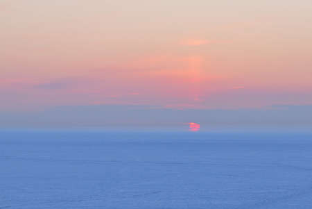Winter sun at sunset against  pink sky and blue snow Stock Photo - 10723232
