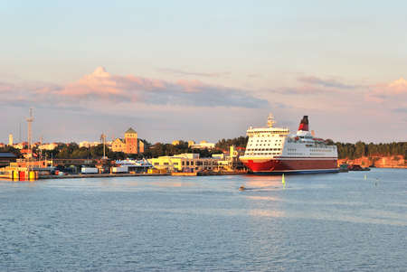 turku: Turku sea-port at sunset with the Castle on the background. Finland Stock Photo