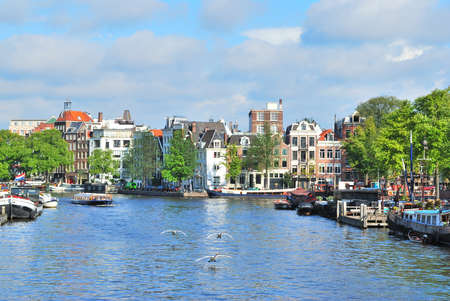 amstel: Beautiful embankment of the river Amstel in Amsterdam in  a sunny summer day