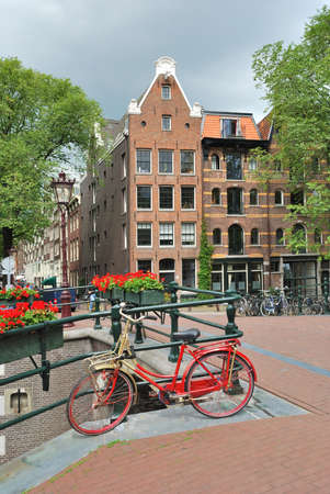 Amsterdam. Beautiful  bridge decorated with flowers over  the canal Brouwersgracht photo