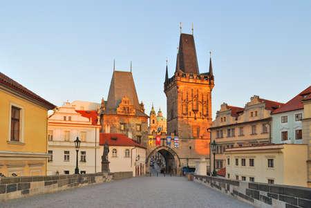 lesser: Prague. Charles Bridge and Lesser Town towers at dawn