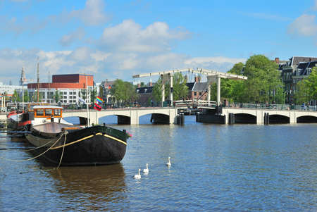 amstel river: Amsterdam. Amstel river and the famous narrow Skinny Bridge Stock Photo