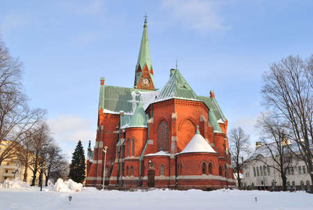 lutheran: Kotka, Finland. Lutheran Cathedral in the rays of the evening sun Stock Photo