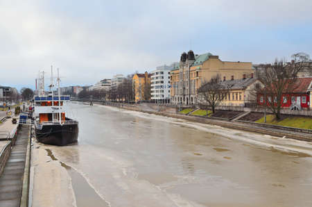 turku: Turku, Finland. View of the city and the Aura river in a cloudy winter day