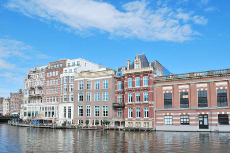 amstel: Amsterdam, Netherlands. Beautiful quay of the Amstel River in a sunny summer day Stock Photo