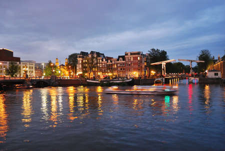 amstel: Amsterdam, Netherlands. Evening lights on the river Amstel Stock Photo