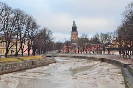Turku, Finland. The embankment of the frozen river Aura in a winter day Stock Photo