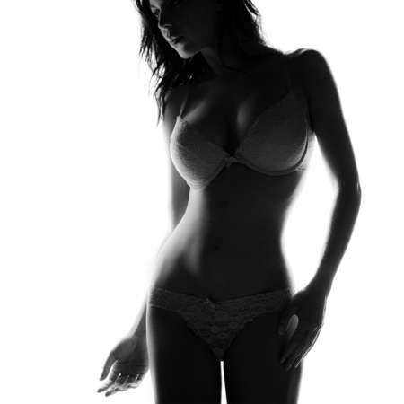Luz de fondo la mujer en ropa interior