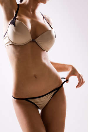Close up of woman body in gold panties and bra Stock Photo - 13231509