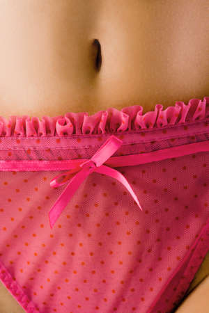 Close up of pink thong and bellybutton