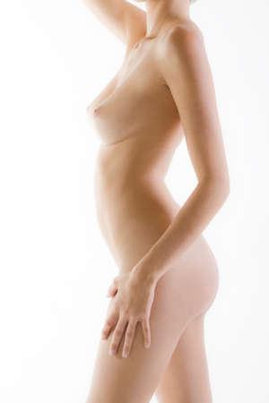 Naked female body side with white luminous background