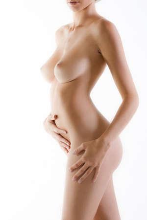 naked female body: Naked female body side with white luminous background
