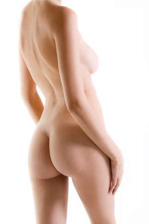 Naked female back side with white luminous background Stock Photo