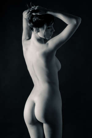 Back nude woman in black and white Stock Photo