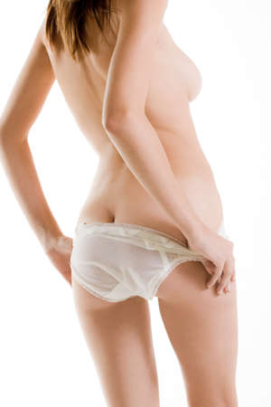 Back of naked woman with white panties Stock Photo