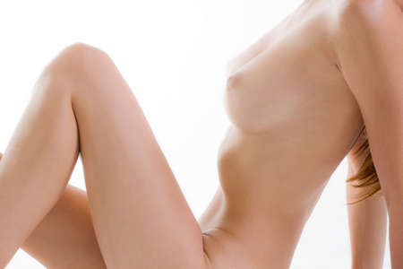 Close up to the nude breast of seated woman